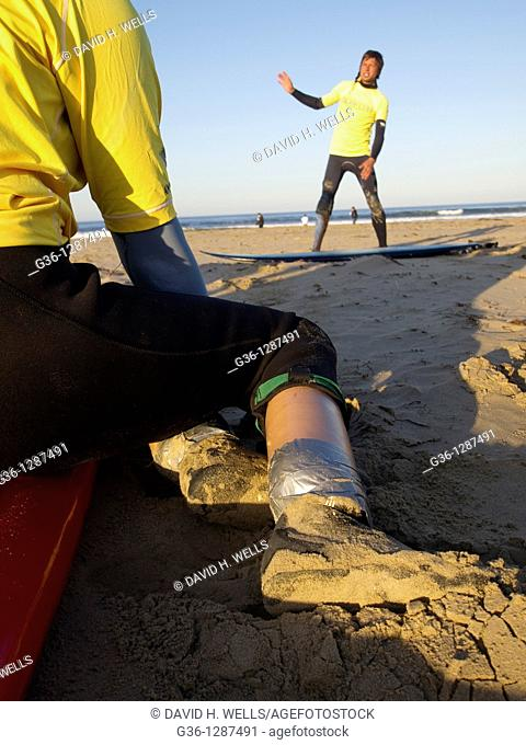 During the Surf Clinic in Pismo Beach, California, sponsored by AmpSurf, Monica DeNatley, who was born without lower legs