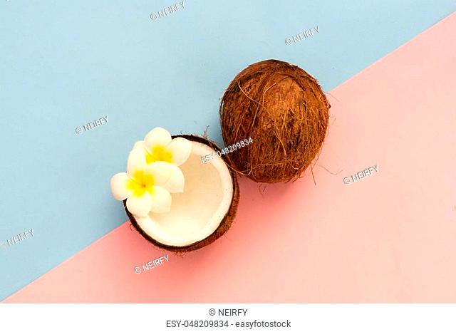 coconut cracked fruit, top view scene minimal style on pink and blue background
