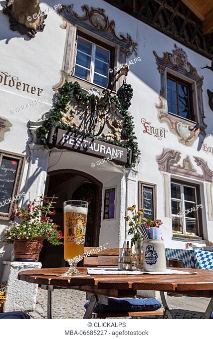 A typical alpine restaurant and glass of German beer Garmisch Partenkirchen Oberbayern region Bavaria Germany Europe