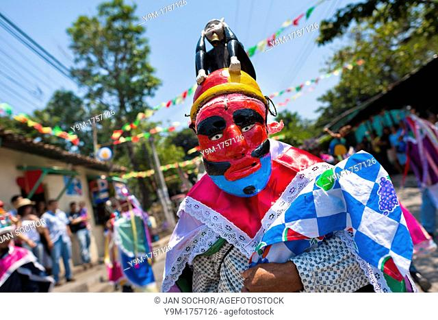 Salvadoran men, dressed as Moors and Christians, perform the traditional dance during the Flower & Palm Festival in Panchimalco, El Salvador