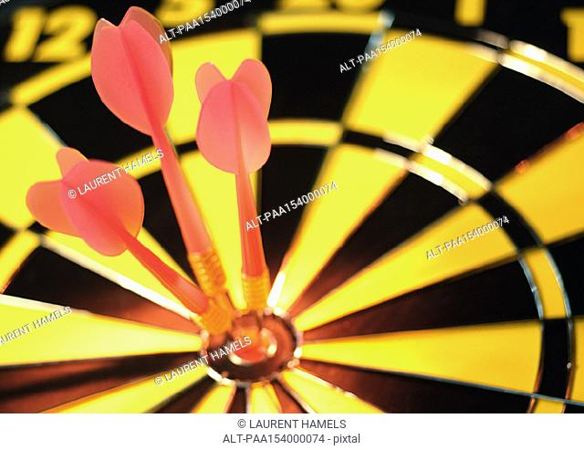 Darts in bullseye of dartboard, close-up