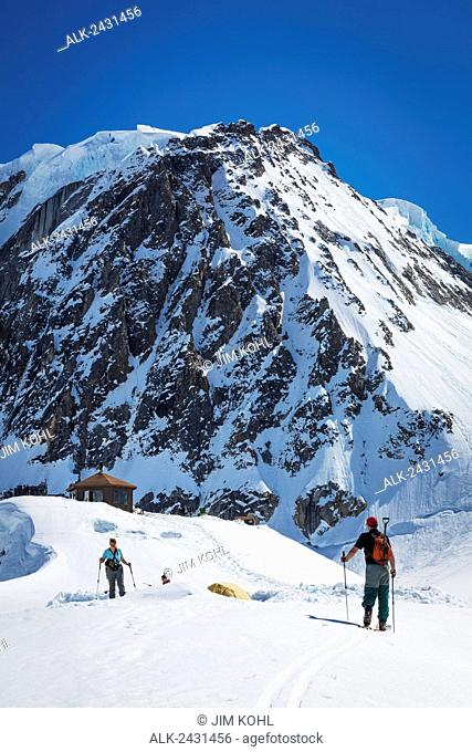 A group of skiers on the Ruth Glacier below the Don Sheldon Mountain House in the Alaska Range, Interior Alaska, Summer