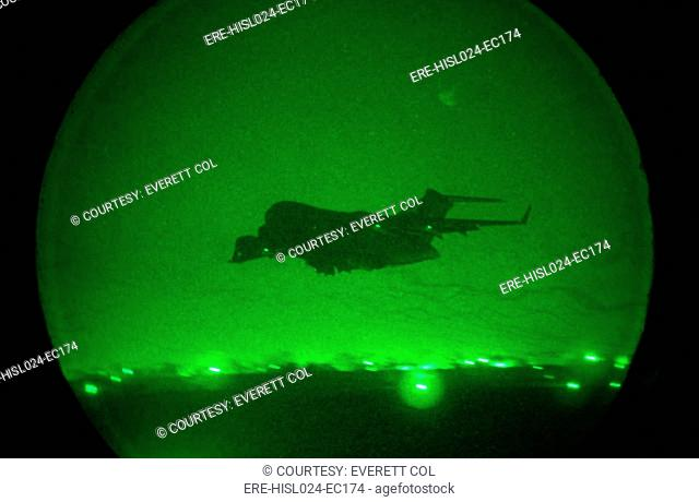 Seen in the green glow of a night scope a C-17 Globemaster military transport takes-off with lights out from an air base in Uzbekistan or Afghanistan after...