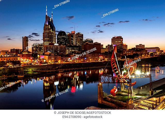 Twilight view of the Nashville Tennessee, skyline with the Cumberland River in the foreground