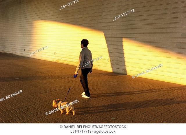 woman with her dog, Ciudad e las Artes y las Ciencias, Valencia, Spain