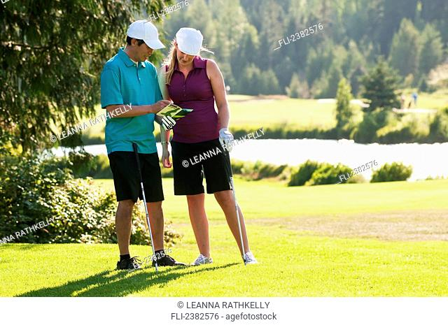 Golfers checking their scores at the Whistler Golf Course; Whistler, British Columbia, Canada