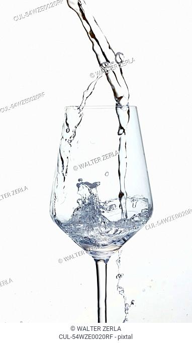 Water pouring in wine glass