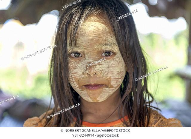 Myanmar (formerly Burma). Kayin State (Karen State). Hpa An. Peasant village. Portrait of a young girl covered of tanaka