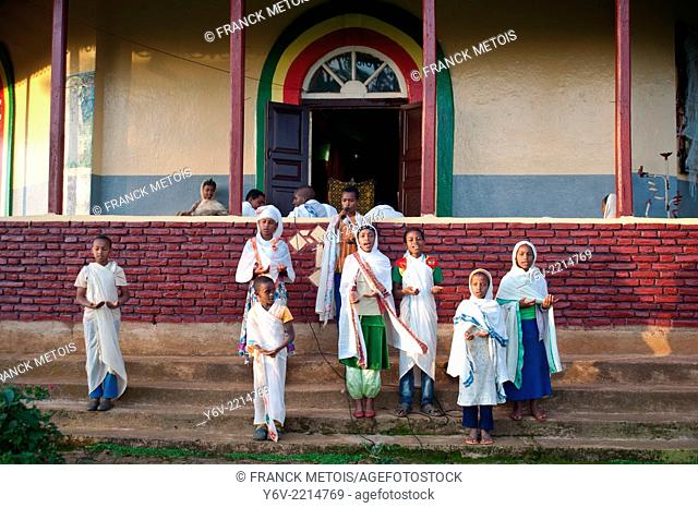 In front of a orthodox church, children are singing. Oromia state, Ethiopia