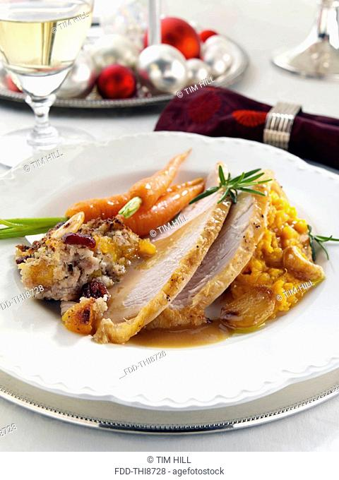 Christmas dinner turkey stuffing carrots and mashed sweet potato