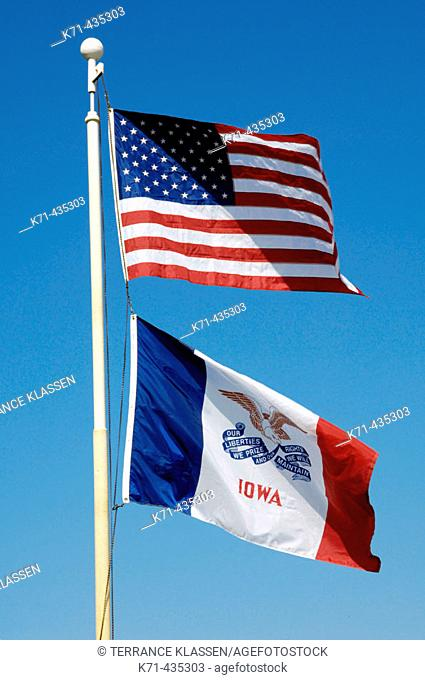 The American and Iowa State flags flying in Pella, Iowa, USA
