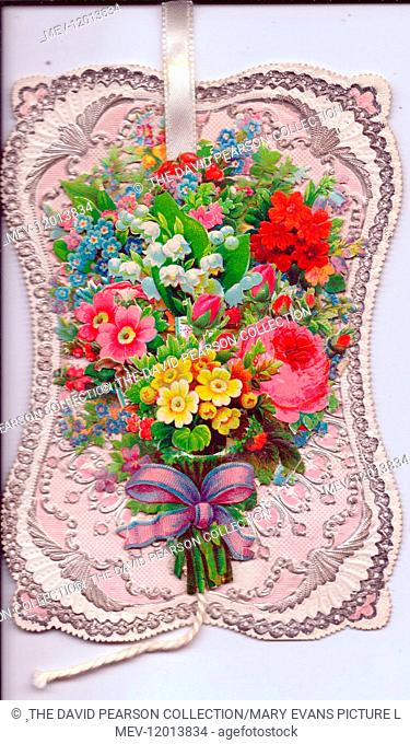 Assorted flowers tied with a ribbon on a greetings card, with silver, pink and white ornate border