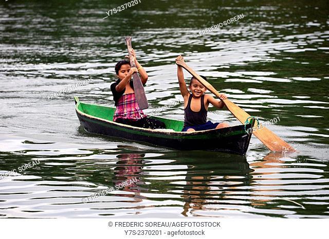 Rowing on rhe Rio Dulce, Guatemala, Central America
