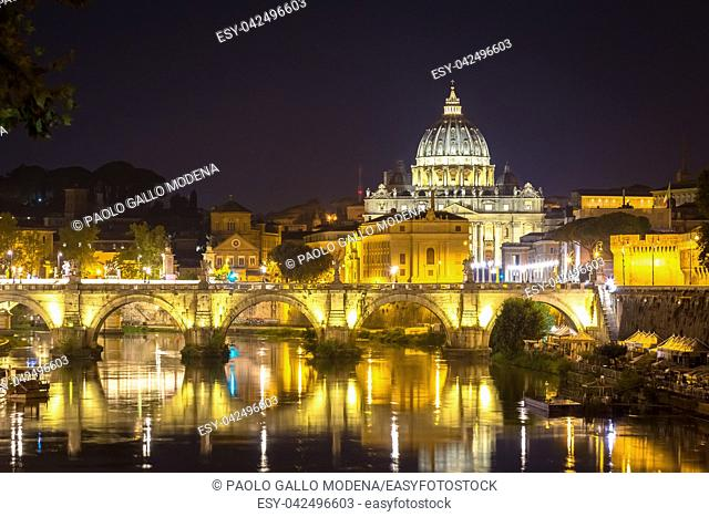 Vatican City, Rome: Saint Peter dome by night and bridge reflection on Tevere river