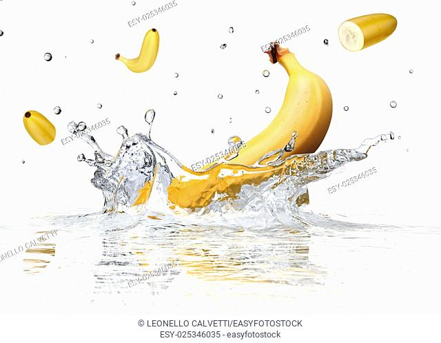 Banana splashing into clear water on white background