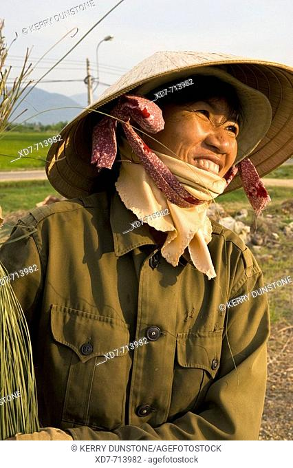 Vietnam Nha Trang Vinh Ngoc Woman working with dried rushes used in mat making