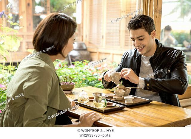 Young smiling couple at teahouse