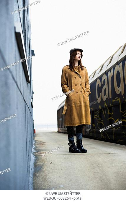 Young woman standing on platform