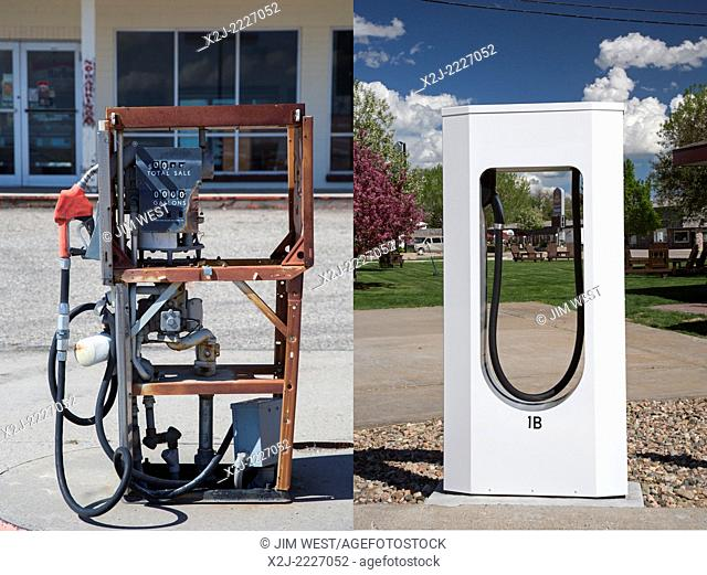Lusk, Wyoming - A stripped gasoline pump (left) at a closed general store. A block away is a Tesla Supercharger in the parking lot of a motel