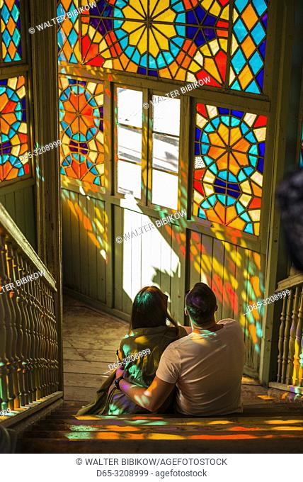 Georgia, Tbilisi, Old Town, traditional Georgian building with stained-glass staircase with visitors, NR