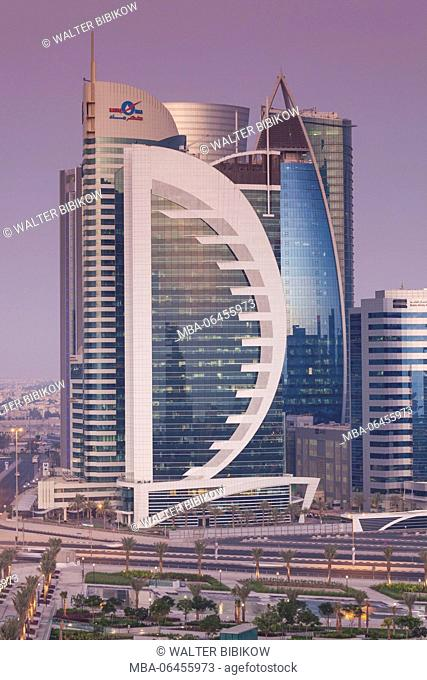 Qatar, Doha, Doha Bay, West Bay skyscrapers, Doha Bank Tower, dusk