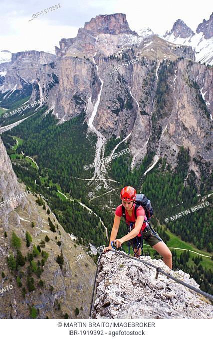 Rock climber climbing the Stevia climbing route in Vallunga in Val Gardena, Dolomites, Alto Adige, Italy, Europe