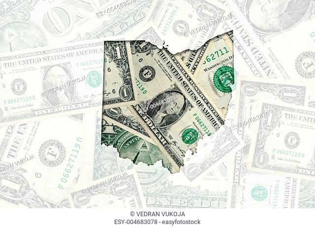 Outline map of ohio with transparent american dollar banknotes i