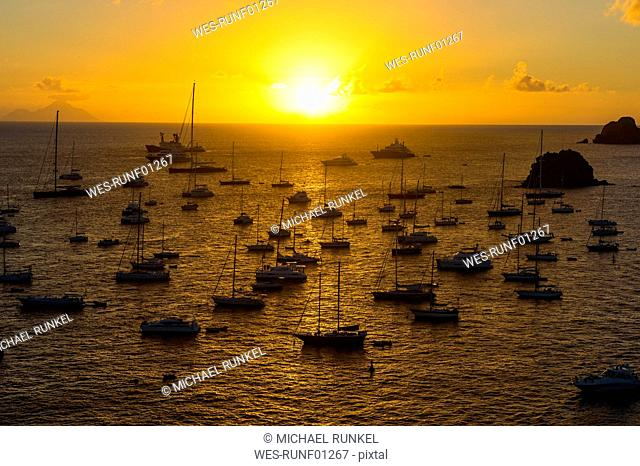 Caribbean, Lesser Antilles, Saint Barthelemy, Sunset over the luxury yachts, in the harbour of Gustavia