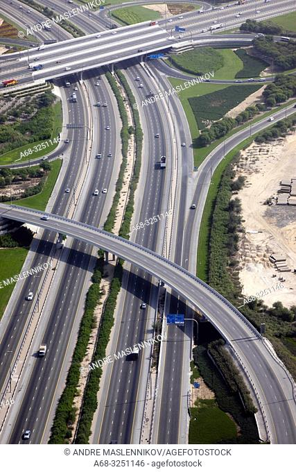 Helicopter view of road crossing Al Khail Road and Dubai - Al Ain Road in Dubai