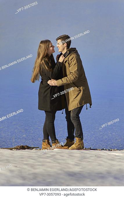 Tegernsee, Germany, couple in winter next to lake