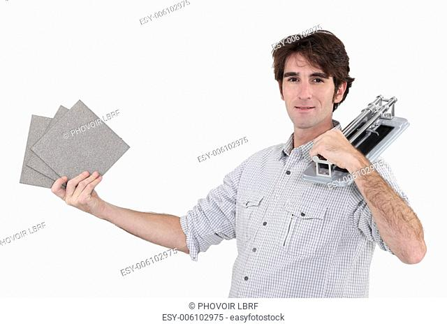 Man holding tile cutter