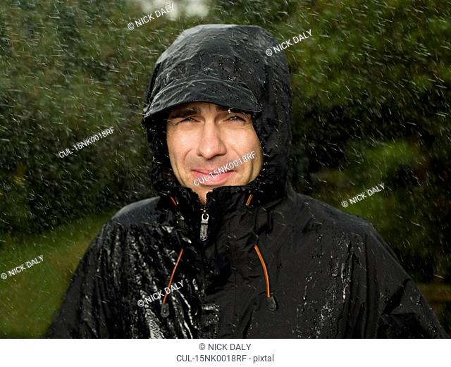 A man getting soaked in the rain