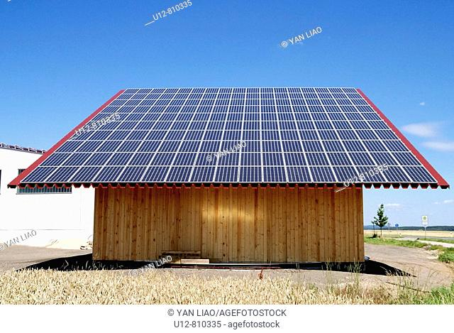 A farmer in Germany is using the whole roof of his barn to get energy for his house with solar power