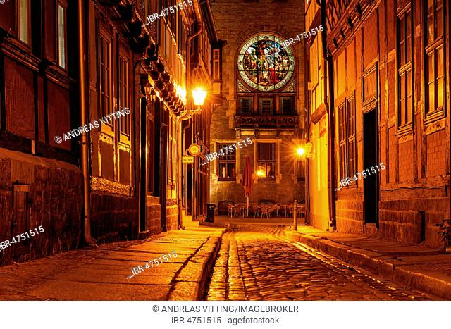 Narrow alley with half-timbered houses, behind the town hall with windows with enlightened stained glass, cobblestones, night scene, UNESCO World Heritage Site