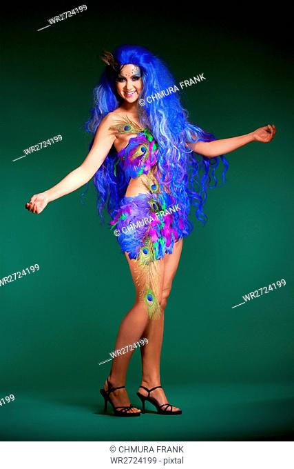 Young Woman in Blue Wig and Dress of Feathers
