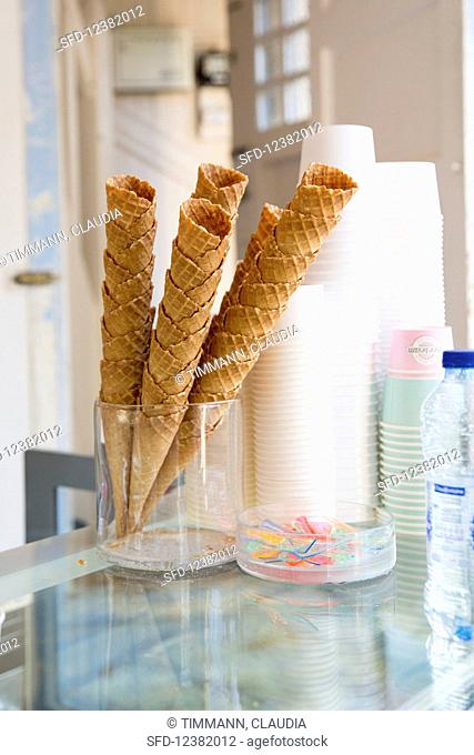 Ice cream cones and tubs in an ice cream parlour
