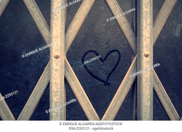 Pinted heart on a closed door,Valencia, Spain