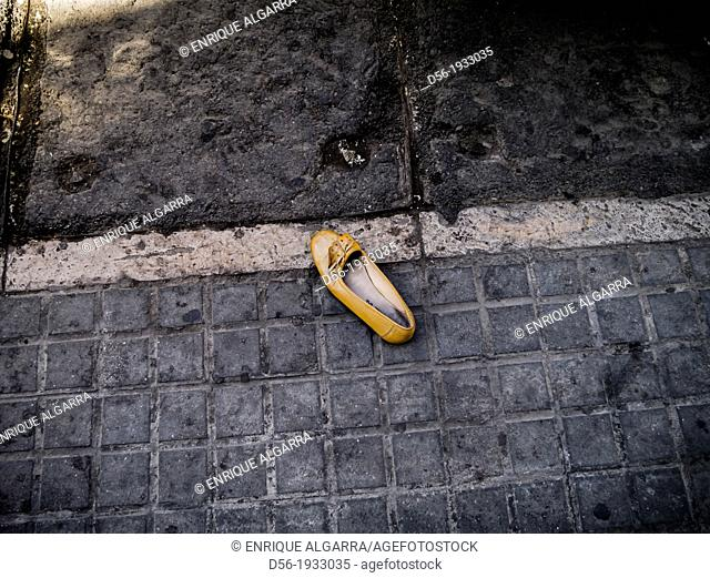 Abandoned shoe in the street, Valencia, Spain