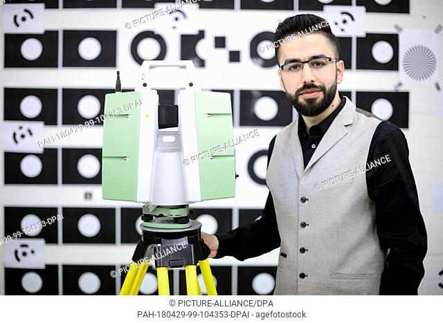"16 April 2018, Stuttgart, Germany: Samer Karam is standing next to a laser scanner. The native Syrian from Aleppo is part of the """"Leadership for Syria""""..."