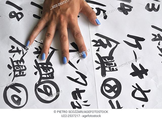 Itoman, Okinawa, Japan: poster with ideograms during a wedding ceremony at Bibi Beach