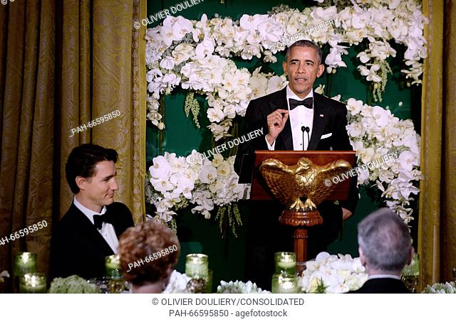 United States President Barack Obama makes remarks as Prime Minister Justin Trudeau of Canada looks on during a toast at the state dinner honoring the Prime...