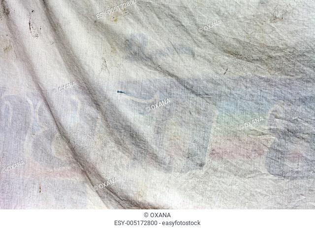 Old dirty white fabric with waves