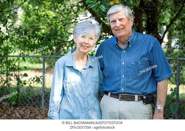 Mature retired couple married 49 years portrait in the park together in love MR Model released MR-1 MR- 2