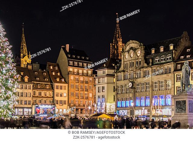 Kleber place in the center of Strasbourg city, wiew with the Christmas tree decorated, and people walking on the place