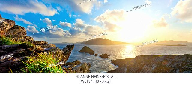 scenic irish west coast, looking from dingle peninsula (Europe`s most westerly mainland point) in western ireland towards blasket islands while the sky is...