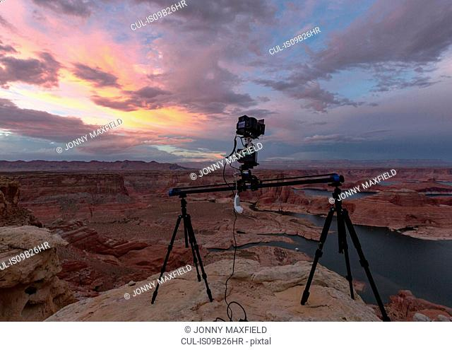 Camera on tripods photographing view of Lake Powell and canyons, Alstrom Point, Utah, USA