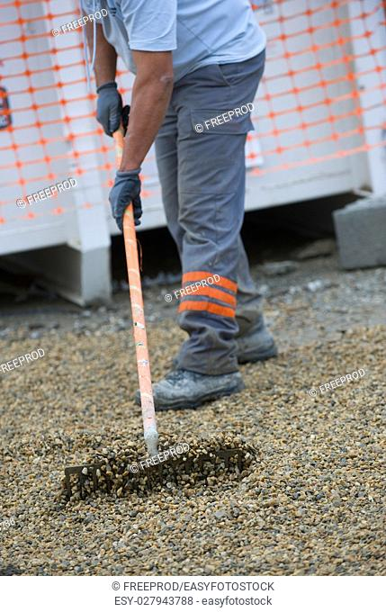 Construction workers sweeping in the installation, Gravel
