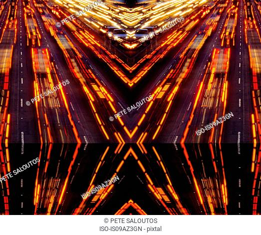 Abstract mirror image of highway traffic light trails at night, Los Angeles, California, USA