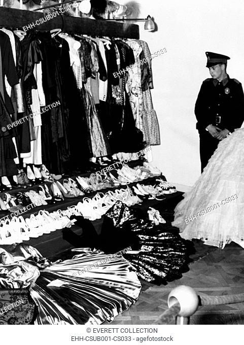 Soldier guards the late Eva Peron's luxury after the overthrow of Argentina's dictator Juan Peron. In addition to jewelry, paintings