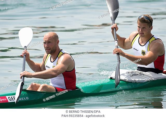 Germany's Ronald Rauhe (L) and Tom Liebscher paddle back zo the shore after finishing second place in the Men's Kayak Double K2 200m final at the 2015 European...